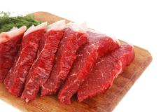 Red beef steak on wood Stock Photos