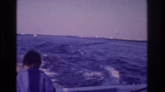 1968: boy at the back of a motor boat OCEAN CITY NEW JERSEY Stock Footage