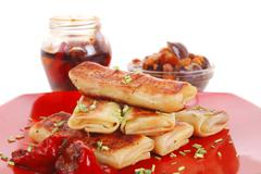 Meat wrapped in a pancake with hot pepper and mushrooms Stock Photos