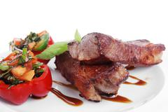 Beef meat steak barbecue garnished vegetable salad and basil Stock Photos