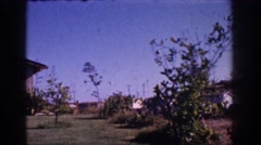 1962: sweeping view of residential rambler with white car. YORBA LINDA Stock Footage