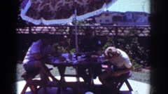 1962: family having lunch outside in the sunshine. YORBA LINDA CALIFORNIA Stock Footage