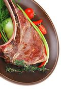 Savory : grilled spare rib on dark dish with pepper and tomato Stock Photos