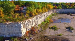 Amazing scenic man-made cliffs remaining from old rock quarry, aerial view Stock Footage