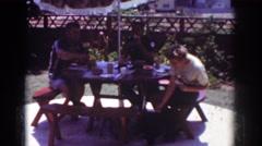 1962: picnic scene people having meal enjoying together YORBA LINDA CALIFORNIA Stock Footage