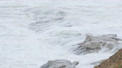 Ocean waves crash on a rocky shore in Cape Breton Stock Footage