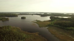 Aerial view of eutrophic bay with dense reed vegetation at a Finnish lake Stock Footage