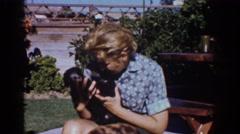 1962: woman holding puppies YORBA LINDA CALIFORNIA Stock Footage