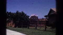 1962: a beautiful summer day on a suburban street in a 1960's american town. Stock Footage