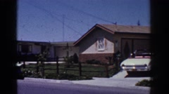 1962: tree area along a residential place with a car parked YORBA LINDA Stock Footage