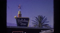 1963: holiday inn sign with palm tree MEMPHIS TENNESSEE Stock Footage