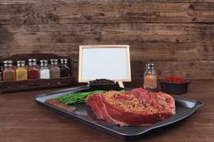 Raw beef fillet on black tray Stock Photos