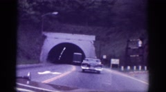 1963: cars moving thru tunnel area dark sunlight bright MEMPHIS TENNESSEE Stock Footage