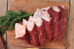 Beef meat steak and chunk on wood Stock Photos