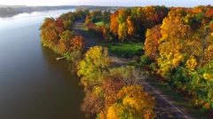Scenic river road in Autumn Splendor, colorful trees, aerial view Stock Footage