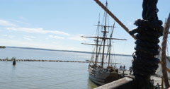 Colonial Sailboat at Dock on River with Tourist Walking Wide, 4K Stock Footage