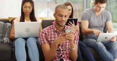 4k, Multi ethnic group of young people using technology. Stock Footage