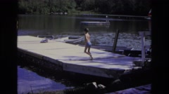 1968: child runs and jumps into water swimming fast OCEAN CITY NEW JERSEY Stock Footage