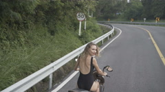 Pretty woman in black swimwear on the motor scooter Stock Footage