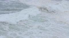 Slow motion of waves landing on rocks in Cape Breton coastline Stock Footage