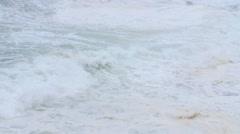 Slow motion waves landing on rocks in Cape Breton coastline Stock Footage