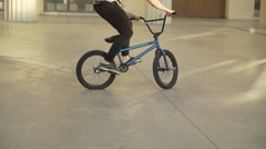 50 fps bicycle jump spin stunt - riding on a street HD HQ daytime Stock Footage