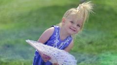 Little girl with fan. Stock Footage