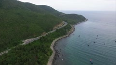 Aerial Views of the Coastline, Rocks, Mountains, Road and Clean Sea Stock Footage
