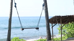 Lonely empty Swing On The Nature Background. Tropical island Bali, Indonesia Stock Footage