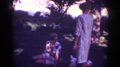 1962: group of people playing with dogs BLAINSPORT PENNSYLVANIA Stock Footage