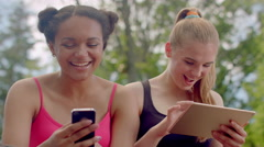 Girls smiling. Attractive girls reading good news.Happy girls laughing Stock Footage