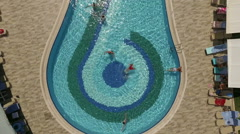 People swimming in the water pool, aerial view Stock Footage