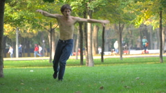 Man dancing in the park Stock Footage