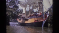 1962: large historical ship with sails partially open, filled with people Stock Footage