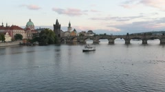 HD timelapse of a Charles Bridge with a boats floating down the river. Stock Footage