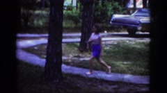1962: girl hides during view of house and lawn RALEIGH NORTH CAROLINA Stock Footage