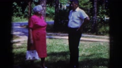 1962: older couple arguing out in the yard. RALEIGH NORTH CAROLINA Stock Footage