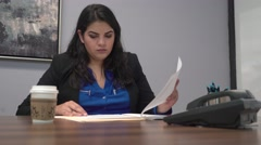 4K Corporate Professional Woman Reviewing Business Charts and Documents Stock Footage
