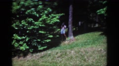 1962: woman taking a picture out in nature. RALEIGH NORTH CAROLINA Stock Footage