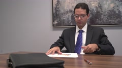 4K Corporate Professional Man Reviewing Business Charts and Documents in Office Stock Footage