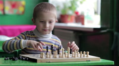 Boy playing chess Stock Footage