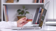 Woman's hands holding a lot of different credit cards and via smart phone for Stock Footage