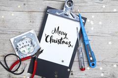 Creative Christmas Card for an electrican business Stock Photos