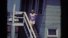 1962: woman is about to take you on a hilarious step by step day in the life Stock Footage