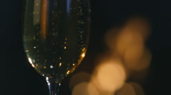 Champagne sparkles in the background Christmas fireplace Stock Footage