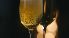 Champagne is poured into a glass Christmas fireplace Stock Footage