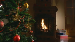 Christmas decor. gifts under the Christmas tree, fireplace. background Stock Footage
