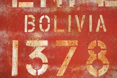 Old rusty painted metal wall with inscriptions Stock Photos