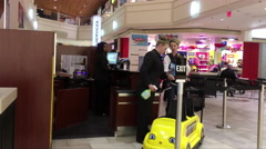 Guest service worker cleaning toy car inside Coquitlam shopping mall Stock Footage