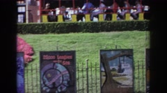 1967: trails of playground field trains moving along the track on a sunny day Stock Footage